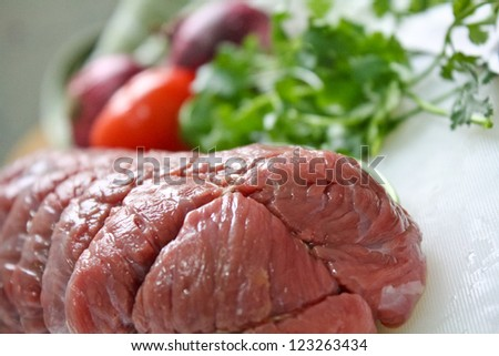 Raw Beef Meat with ingredient on a plate - stock photo