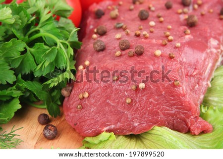 Raw beef meat with spices and vegetables close up - stock photo