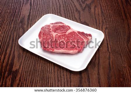 Raw beef rib eye steak  - stock photo