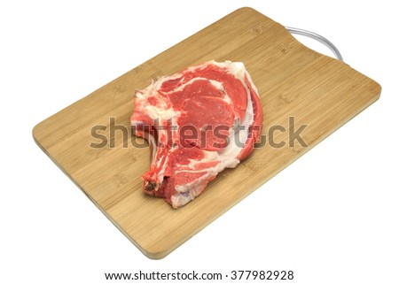 Raw Beef Ribeye Steak On The Wood Cutting Board Isolated On White Background, Close Up, Top View - stock photo