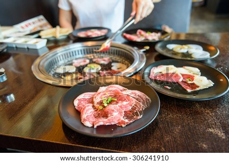 Raw beef slice for barbecue or Japanese style yakiniku - stock photo