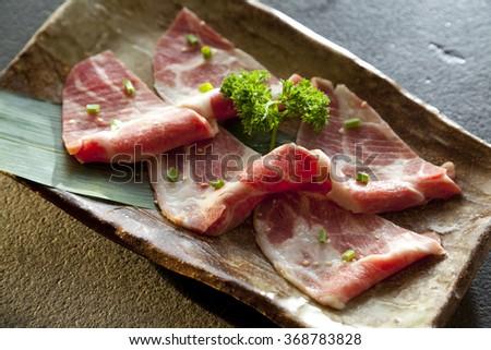 Raw beef slice for barbecue or Japanese style yakiniku - stock photo