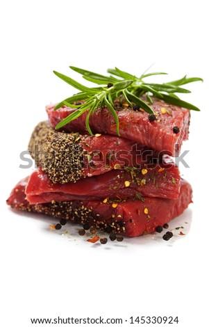 Raw beef steak over white - stock photo