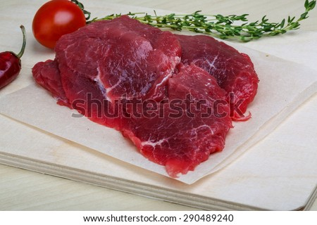 Raw beef steak - ready for cooking with thyme