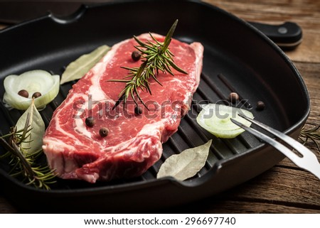 Raw beef steak ready to grill. Selective focus. - stock photo
