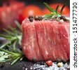 Raw beef steak with peppercorns and herbs. - stock photo