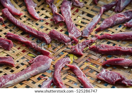 raw beef with spices drying in the sun