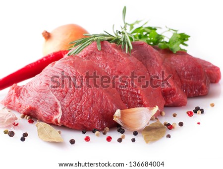 raw beef with spices on white background - stock photo