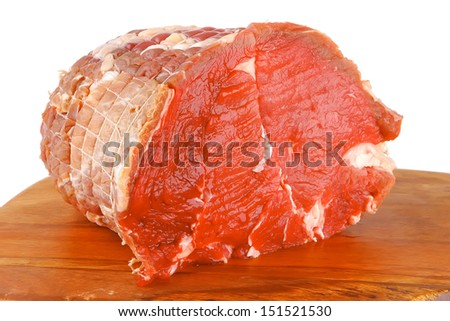 raw bloody beef meat on cutting plate