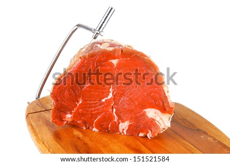 raw bloody beef meat on cutting plate - stock photo