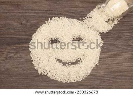 Raw brown rice in a Bottle. Selective focus. Closeup. - stock photo