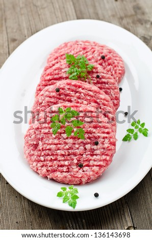 Raw burgers for hamburgers - stock photo