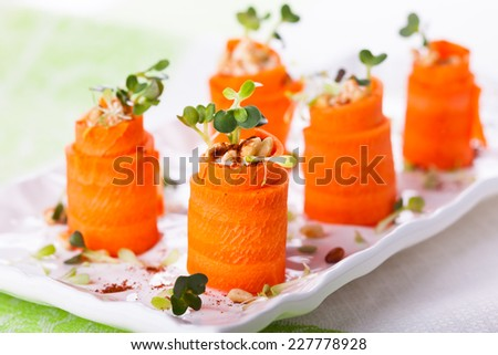 Raw Carrot Roll-Ups with hummus and sprouts for holiday - stock photo