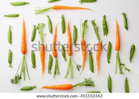 raw carrots and green peas pattern, healthy food