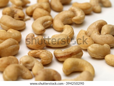 Raw cashew nuts on white background, detailed view