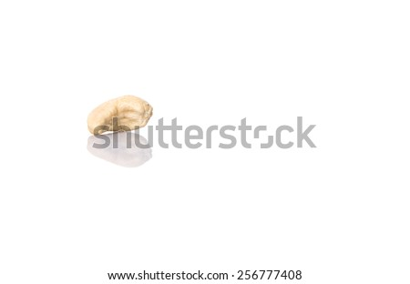 Raw cashew nuts over white background - stock photo