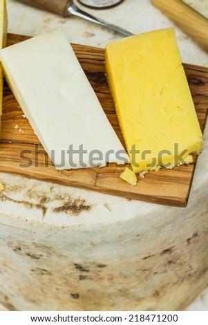 Raw cheese wheel - stock photo