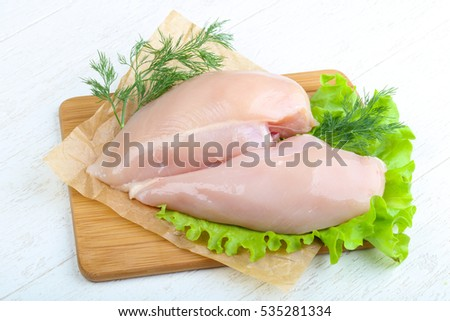Raw chicken breast with dill ready for cooking