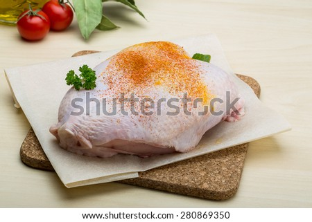 Raw chicken breast with spices ready for cooking