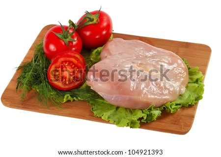 Raw chicken fillet with vegetables
