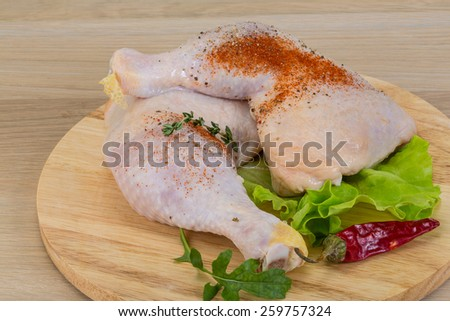 Raw chicken leg with herbs ready for cooking - stock photo