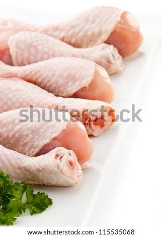 Raw chicken legs - stock photo