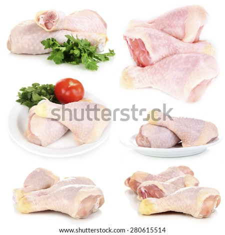 Raw chicken legs isolated on white - stock photo