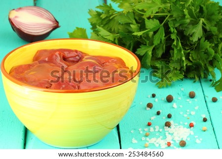 Raw chicken liver in bowl - stock photo