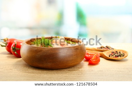 raw chicken meat in bowl, on wooden table - stock photo