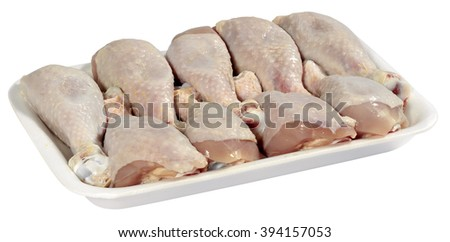 raw chicken meat in plastic tray isolated on white background