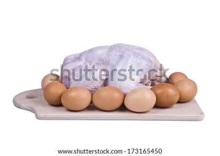 Raw chicken on a board with eggs isolated over white - stock photo