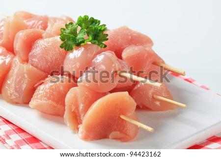 Raw chicken skewers  - stock photo