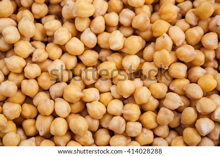 Raw chickpea beans macro background, vegan healthy nutrition, selective focus - stock photo