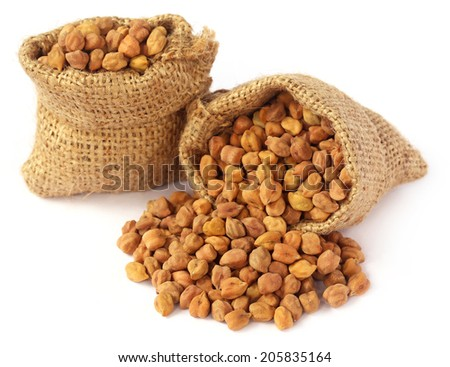 Raw Chickpea with sack over white background - stock photo