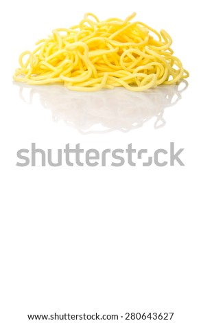 Raw chinese yellow noodles over white background