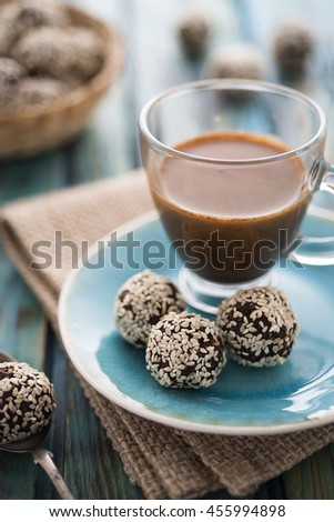 Raw cocoa candies with sesame seeds