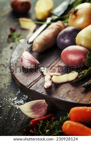 Raw colorful potatoes and vegetables ready for cooking. Fresh organic vegetables. Food background. Healthy food from garden - stock photo