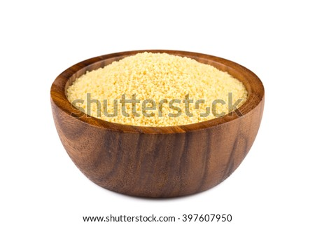 Raw couscous in a wooden bowl on white background - stock photo