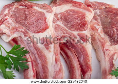 raw cutlet of lamb with vegetables - stock photo
