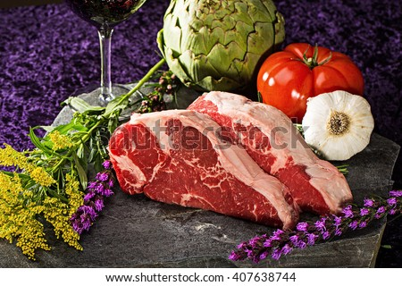 Raw cuts of delicious, fatty, New York Steaks - stock photo