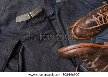 Raw denim jeans selvedge, japan raw denim jeans, dark blue jean texture with leather boots