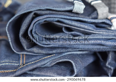 Raw denim jeans texture and close up, Dark blue jeans.