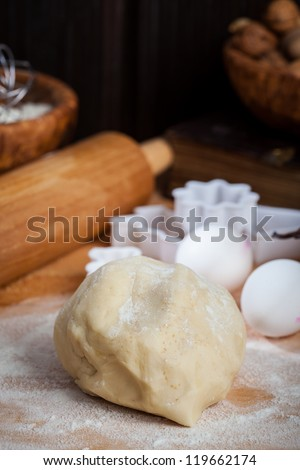 Raw dough with baking ingredients for baking Christmas cookies - stock photo