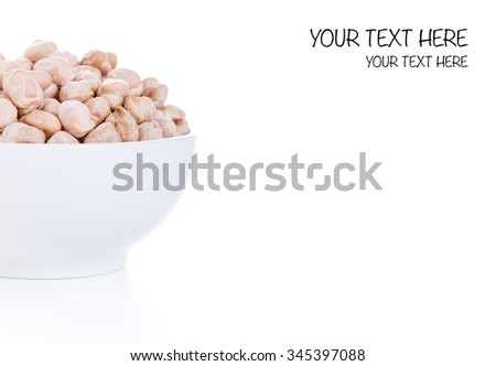 Raw dry chickpeas in bowl on white background, healthy vegan food with a lot of protein