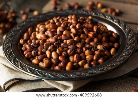 Raw Dry Organic Fava Beans in a Bowl - stock photo