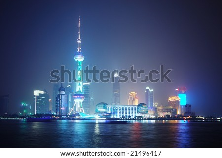 RAW - Economic Center of China - Night View of Shanghai with Pearl Tower - stock photo