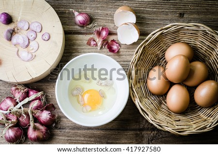 Raw egg in a black bowl - stock photo