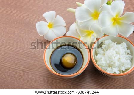 Raw Egg in soy sauce and white rice,Tamago kake gohan - stock photo