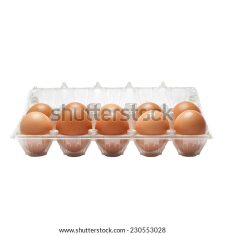 raw eggs in a plastic carton isolated on white background - stock photo