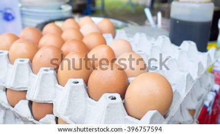 Raw eggs on the tray ready to sell in Thailand.
